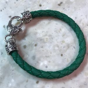 Braided leather bracelet with silver clasp